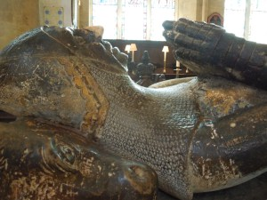 A knight in full armor lies in state in Christ Church Chapel, Oxford.