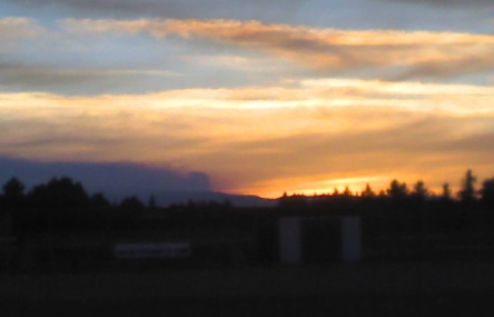 Smoke from one of our fires competes with sunset.